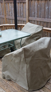 Patio table, 4 chairs with their covers