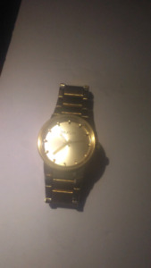 "NIXON ""The Cannon"" men's gold watch"