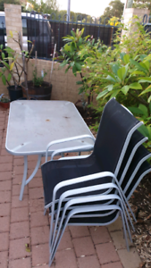Outdoor glass table and chairs