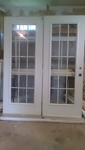 Steel exterior french doors with casing
