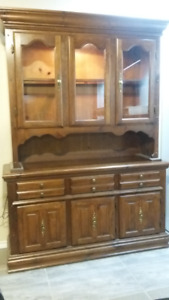 solid oak china cabinet with matching table, 6 chairs and leaf!
