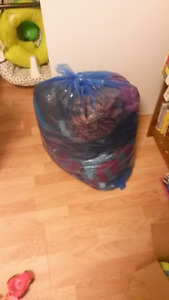 Garbage bag full of boys clothes