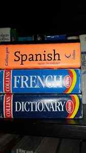 3 pocket sized dictionaries- English, French & Spanish