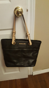 Gently used authentic Michael Kors black leather purse.