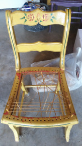 Wooden chair with cain seat