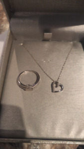 White gold ring and matching necklace with diamonds