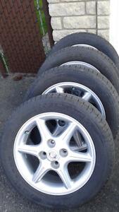 4 mags nissan sur pneus Michelin 205 55 16 ,,350 $  514 571 6904