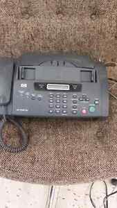 HP 1040 fax machine and landline.