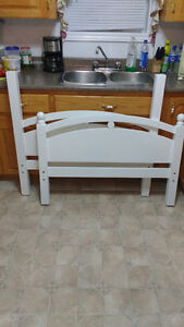 Twin wood headboard and footboard and rails white in color