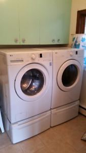 Lg Electric Washer and Dryer Set with Drawer Stands.