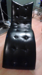 Black faux leather chaise lounge chair
