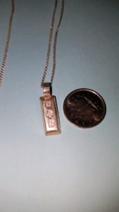 Sterling silver bar pendant and chain.