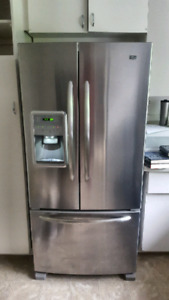Stainless steel Maytag refridgerator and ceramic stove stove