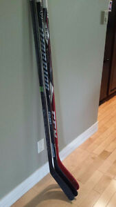 3 left handed senior hockey sticks for sale.
