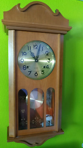 Vintage antique working pendulum wall clock