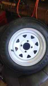 Brand new 4.80-12 trailer tire on 4 bolt rim will trade for 15""