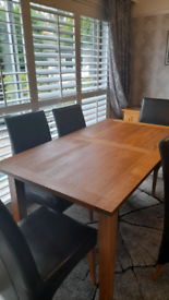 LARGE Solid wooden dining table with 6 leatherette chairs Offers Welcome