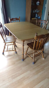Laminate top table with wood chairs