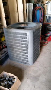 CENTRAL AIR CONDITIONER AND COIL. GOODMAN