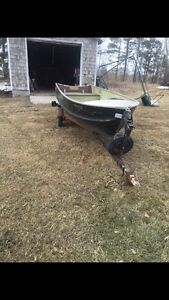 14 ft boat and 15 horse motor