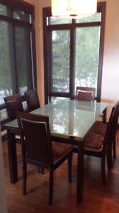 Modern glass dining table with six chairs