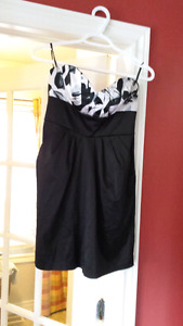 Ladies black and white size 4-6 strapless grad/prom dress