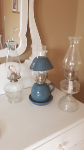THREE OIL LAMPS for sale.25.00 each