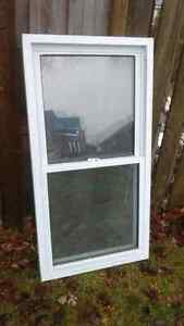 Double hung white vinyl window