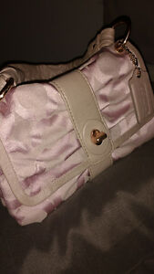 Blush pink and rose gold Coach purse