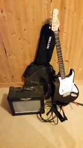 Electric guitar, amp, patch cord, stand, case