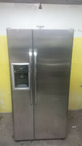 GE Stainless side by side refrigerator/freezer yr 2013