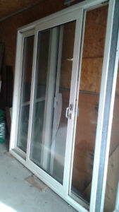 7ft by 7ft patio door with roll screen included