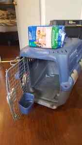 Medium plastic kennel and puppy diapers