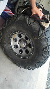 37 inch nitto mud grapplers, 5 rims, 8 bolt dodge