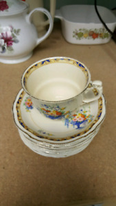 1944 Royal Winton teacup (one) and 9 saucers