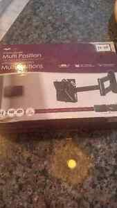 Tv wallmount multiposition new in box never used 12-25 inch