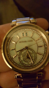 Micheal Kors pink gold 24 cg gold watch full of diamonds