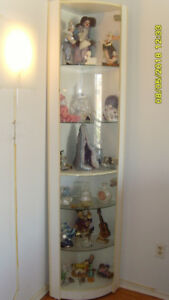 GLASS CORNER WITH SHELVES AND DOORS $90