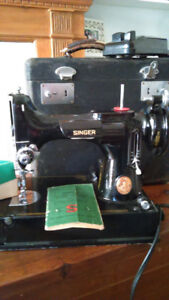 Singer featherweight sewing machine and one for parts