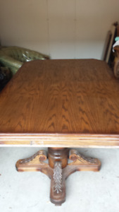 solid oak wooden table 2 captains chairs and 4 regular chairs