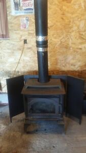 Woodstove With Pipe and Heat Reflector