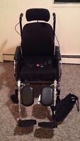 Tilt wheelchair with roho cushion invacare with foot rests.