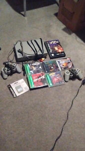 playstation with 6 games 2 controllers memory card