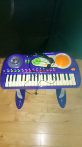 Kids piano and headset microphone