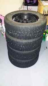 """16"""" Goodyear Ultra Grip ice snow tires and steel rims."""