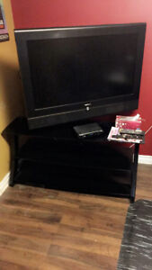 """Black glass top 3 teer tv stand. Holds up to 55"""" tv."""
