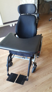 Tillt wheelchair with tables for sale