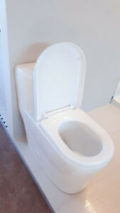 BRAND NEW TOILET on SALE !! CLEARANCE - NO TAX -Reg. Price $699