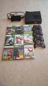 X Box 360 with 4 controllers and 9 games