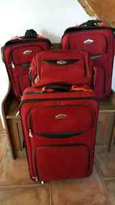 One big suitcase one medium and 1 small and a carry on Cornwall Ontario image 2